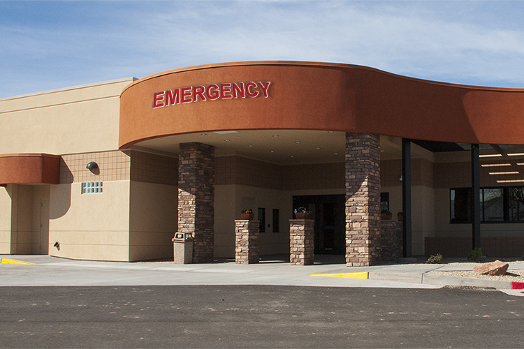 "Entrance to a building with signage that reads ""emergency"""