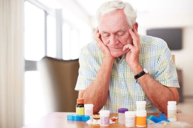 man with medications