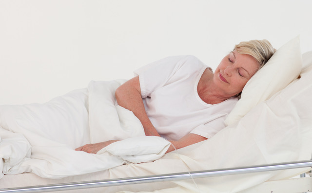 elderly patient lying in bed
