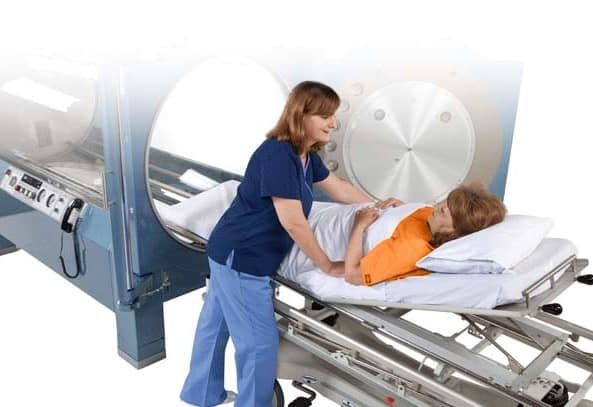 patient and nurse with hyperbaric chamber