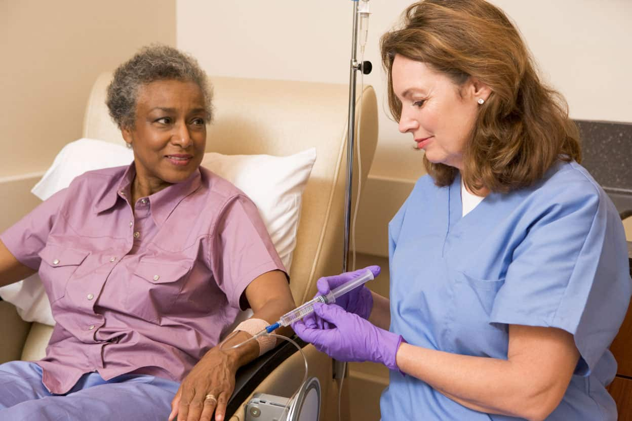 nurse with patient receiving infusion